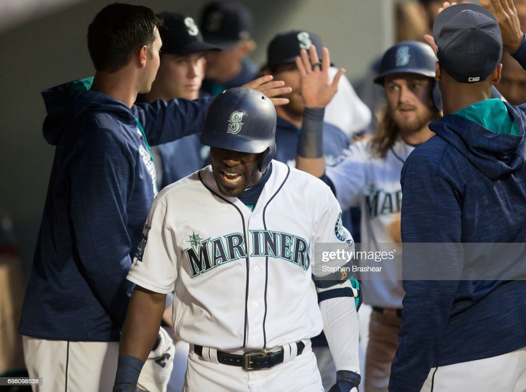 Guillermo Heredia #5 of the Seattle Mariners reacts in the dugout after hitting a two-run home run off of starting pitcher Anibal Sanchez #19 of the Detroit Tigers that also scored Taylor Motter #21, back right, of the Seattle Mariners during the fifth inning of a game at Safeco Field on June 19, 2017 in Seattle, Washington.