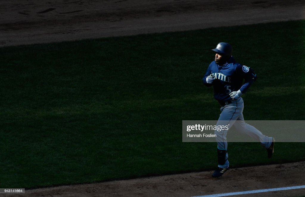 Guillermo Heredia #5 of the Seattle Mariners rounds the bases after hitting a solo home run against the Minnesota Twins during the eighth inning of the game on April 7, 2018 at Target Field in Minneapolis, Minnesota. The Mariners defeated the Twins 11-4.