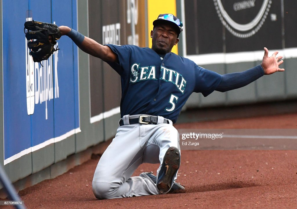Guillermo Heredia #5 of the Seattle Mariners slides as he catches a foul ball hit by Melky Cabrera #53 of the Kansas City Royals in the first inning in game two of a doubleheader at Kauffman Stadium on August 6, 2017 in Kansas City, Missouri.