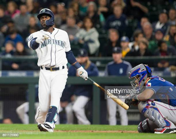 Guillermo Heredia of the Seattle Mariners swings around as he strikes out swinging in the third inning against Cole Hamels of the Texas Rangers at...