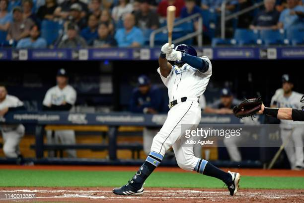Guillermo Heredia of the Tampa Bay Rays hits a 2RBI single in the first inning against Kyle Freeland of the Colorado Rockies at Tropicana Field on...