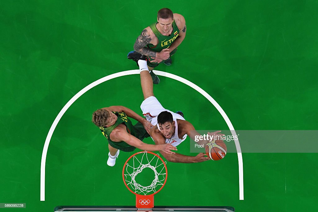 Guillermo Hernangomez Geuer #14 of Spain goes to the basket against Antanas Kavaliauskas #12 and Robertas Javtokas #15 of Lithuania on Day 8 of the Rio 2016 Olympic Games at Carioca Arena 1 on August 13, 2016 in Rio de Janeiro, Brazil.