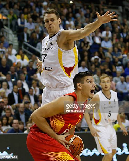 Guillermo Hernangomez of Spain is blocked by Johannes Voigtmann of Germany during the FIBA EuroBasket 2015 Group B basketball match between Germany...