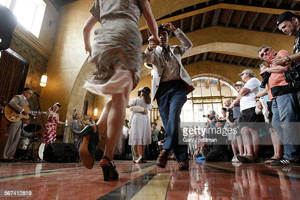 Guillermo Juarez swing dances with Carmen Heath during Union Station's celebration of its 75th anniversary on May 3 in Los Angeles Visitors watched...