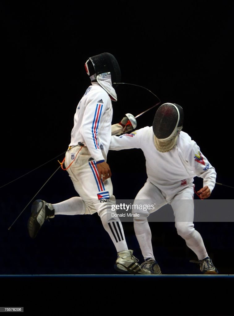 Guillermo Madrigal of Cuba breaks his sword on Wolfgang Mejias of Venezula in the Gold Medal Final of the Men's Team Sabre during the XV Pan American Games on July 20, 2007 at Riocentro Pavilhao in Rio De Janeiro, Brazil. Cuba beat Venezula for the gold medal.