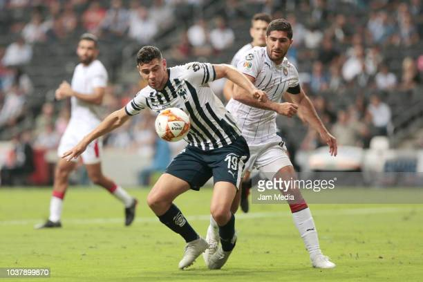 Guillermo Madrigal of Monterrey and Jair Pereira of Chivas fight for the ball during the 9th round match between Monterrey and Chivas as part of the...
