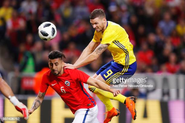 Guillermo Maripan of Chile and Marcus Berg of Sweden competes for the ball during the International Friendly match between Sweden and Chile at...
