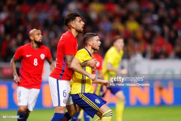 Guillermo Maripan of Chile and Marcus Berg of Sweden during the International Friendly match between Sweden and Chile at Friends arena on March 24...