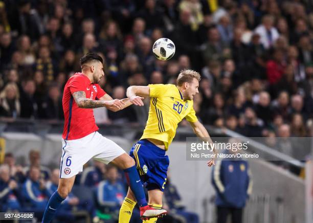 Guillermo Maripan of Chile and Ola Toivonen of Sweden competes for the ball during the International Friendly match between Sweden and Chile at...