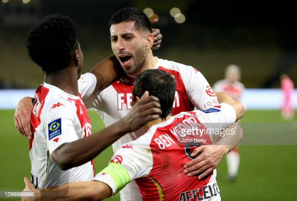 Guillermo Maripan of Monaco celebrates his goal with teammates during the Ligue 1 match between FC Nantes and AS Monaco at Stade de la Beaujoire on...