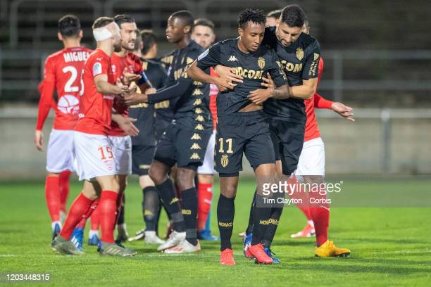 February 01: Guillermo Maripan of Monaco restrains Gelson Martins of Monaco after he pushed referee Mikael Lesage after receiving a red card during...