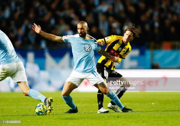 Guillermo Molins of Malmo FF and Erik Friberg of BK Hacken during the Allsvenskan match between Malmo FF and BK Hacken at Malmoe Stadion on April 1...