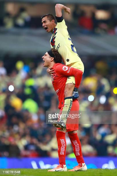 Guillermo Ochoa and Paul Aguilar of America celebrate after winning the Semifinals second leg match between America and Morelia as part of the Torneo...