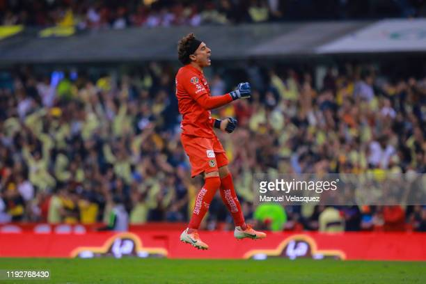 Guillermo Ochoa goalkeeper of America celebrates the second scored goal of his team during the Semifinals second leg match between America and...