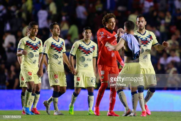 Guillermo Ochoa goalkeeper of America celebrates with teammates after winning the 5th round match between Queretaro and America as part of the Torneo...