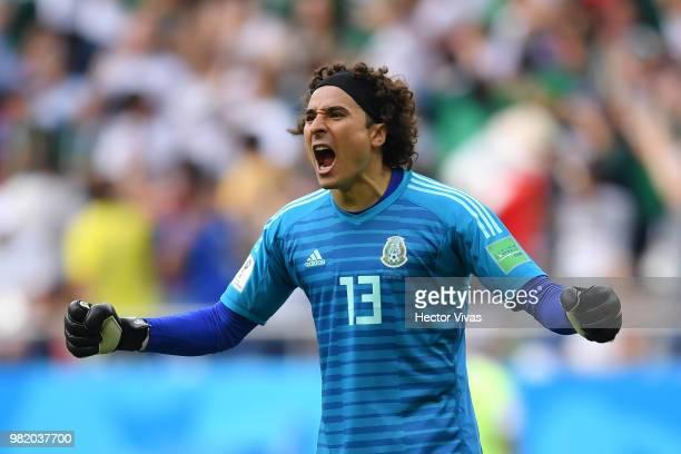 Guillermo Ochoa goalkeeper of Mexico celebrates the opening goal scored by Carlos Vela during the 2018 FIFA World Cup Russia group F match between...