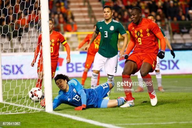 Guillermo Ochoa goalkeeper of Mexico - Romelu Lukaku forward of Belgium scores and celebrates during a FIFA international friendly match between...