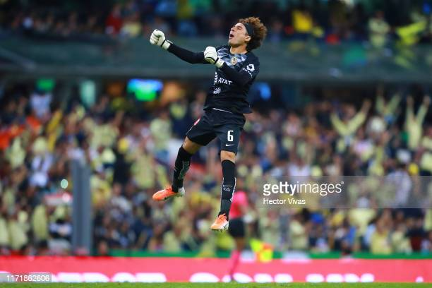 Guillermo Ochoa of America celebrates the fourth goal of his team during the 12th round match between America and Chivas as part of the Torneo...