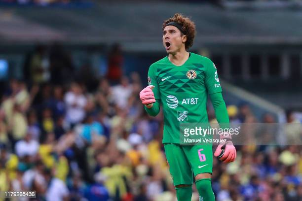 Guillermo Ochoa of America celebrates the second scored goal by Henry Martin of America during the 13th round match between Cruz Azul and America as...