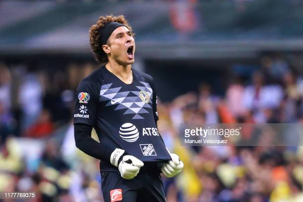 Guillermo Ochoa of America celebrates the second scored goal of America during the 12th round match between America and Chivas as part of the Torneo...