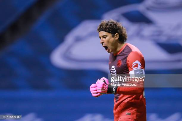 Guillermo Ochoa of America celebrates the third scored goal of America during the 9th round match between Puebla and America as part of the Torneo...