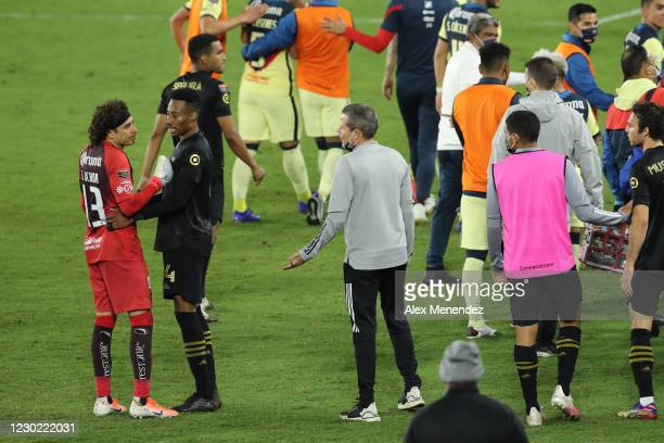 Guillermo Ochoa of Club America is held back as he argues with a Los Angeles FC staff member during the CONCACAF Champions League semifinal game at...