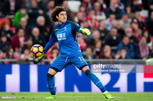 Guillermo Ochoa of Granada CF controls the ball during the La Liga match between Athletic Club Bilbao and Granada CF at San Mames Stadium on February...