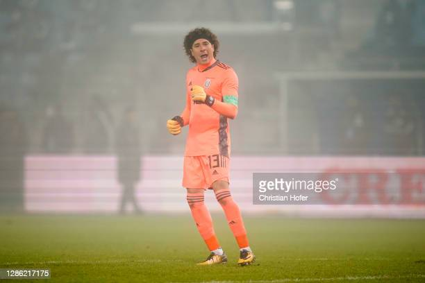 Guillermo Ochoa of Mexico celebrates after his teammate Hirving Lozano of Mexico scored their sides second goal during the international friendly...
