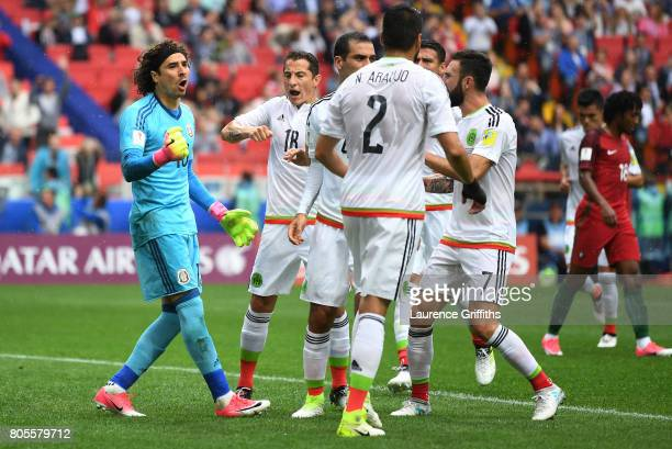 Guillermo Ochoa of Mexico celebrates saving a penalty with his Mexico team mates during the FIFA Confederations Cup Russia 2017 PlayOff for Third...