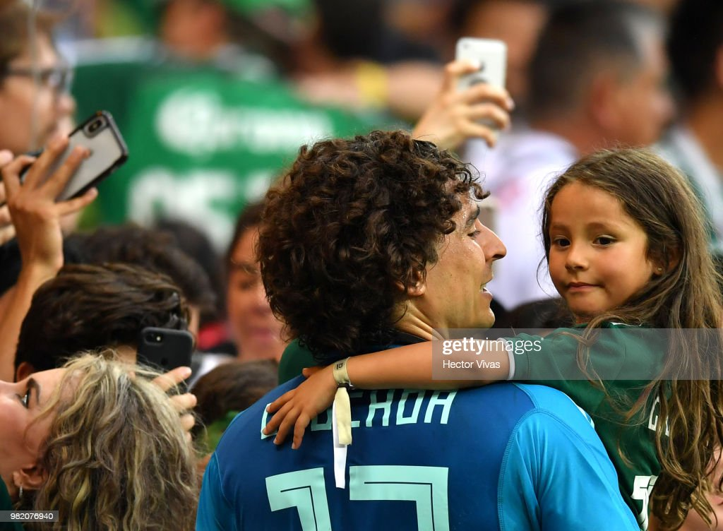 Guillermo Ochoa of Mexico celebrates with his daughter following his sides victory in the 2018 FIFA World Cup Russia group F match between Korea Republic and Mexico at Rostov Arena on June 23, 2018 in Rostov-on-Don, Russia.