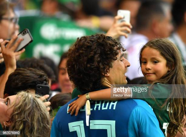 Guillermo Ochoa of Mexico celebrates with his daughter following his sides victory in the 2018 FIFA World Cup Russia group F match between Korea...