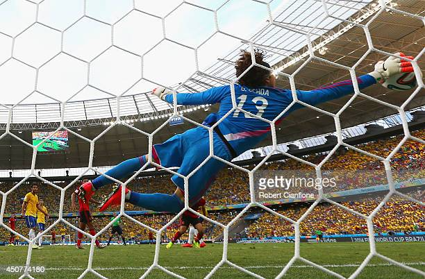 Guillermo Ochoa of Mexico dives to make a save during the 2014 FIFA World Cup Brazil Group A match between Brazil and Mexico at Castelao on June 17...