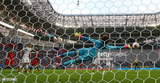Guillermo Ochoa of Mexico dives to make a save during the FIFA Confederations Cup Russia 2017 Group A match between Portugal and Mexico at Kazan...