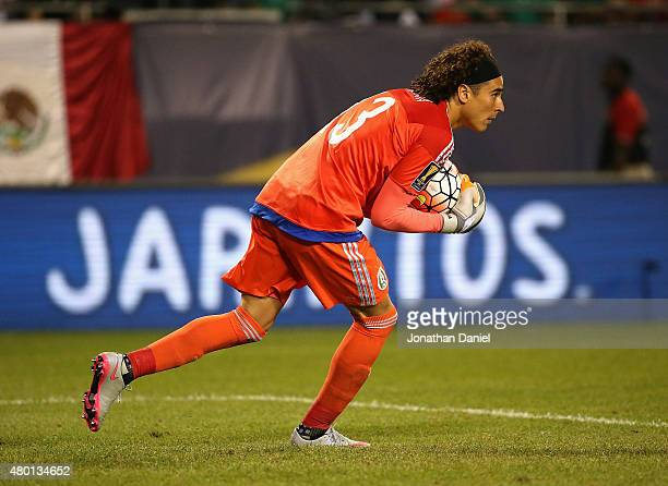 Guillermo Ochoa of Mexico makes a save against Cuba during a match in the 2015 CONCACAF Gold Cup at Soldier Field on July 9 2015 in Chicago Illinois...
