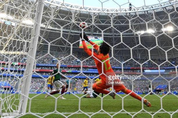 Guillermo Ochoa of Mexico makes a save during the 2018 FIFA World Cup Russia Round of 16 match between Brazil and Mexico at Samara Arena on July 2...