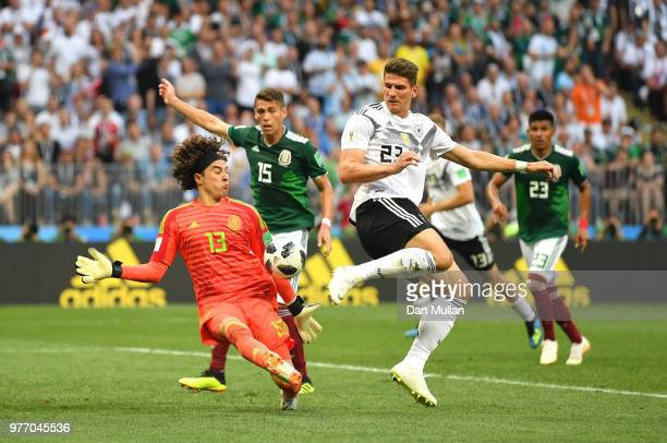 Guillermo Ochoa of Mexico makes a save from a shot by Mario Gomez of Germany during the 2018 FIFA World Cup Russia group F match between Germany and...