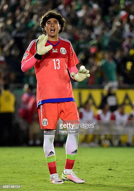 Guillermo Ochoa of Mexico reacts after a save on a shot from Jamaica during Copa America Centenario at Rose Bowl on June 9 2016 in Pasadena California