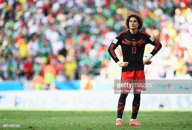 Guillermo Ochoa of Mexico reacts after the 12 defeat in the 2014 FIFA World Cup Brazil Round of 16 match between Netherlands and Mexico at Estadio...