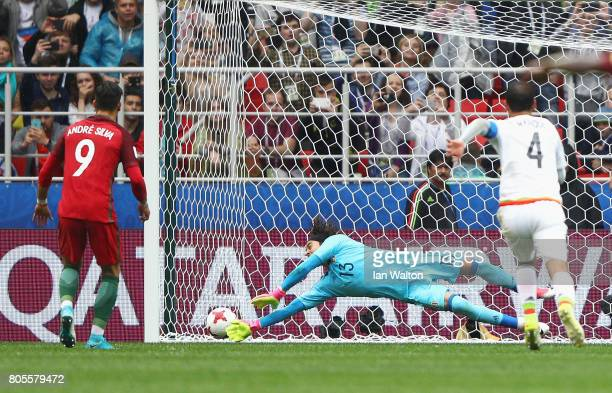 Guillermo Ochoa of Mexico saves Andre Silva of Portugal penalty during the FIFA Confederations Cup Russia 2017 PlayOff for Third Place between...