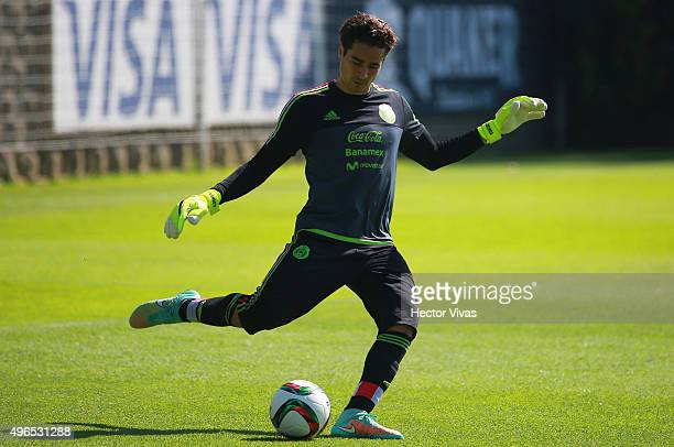 Guillermo Ochoa takes a shot during a training session at Centro de Alto Rendimiento on November 10 2015 in Mexico City Mexico Mexico will face El...