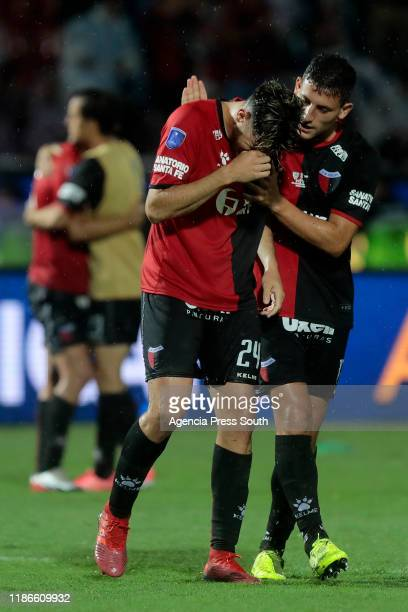 Guillermo Ortiz is comforted by teammate Tomas Chancalay after losing the final of Copa CONMEBOL Sudamericana 2019 between Colon and Independiente...