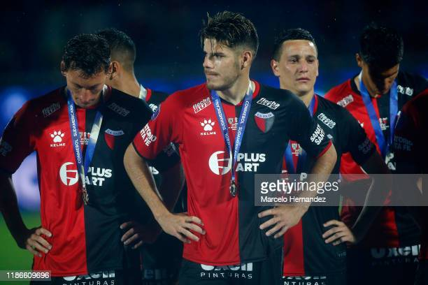 Guillermo Ortiz of Colon and teammates look dejected as they receive the second place medal after the final of Copa CONMEBOL Sudamericana 2019...