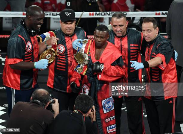 Guillermo Rigondeaux and his team pose for photos in the ring after he retained his WBA super bantamweight title with a firstround knockout of Moises...