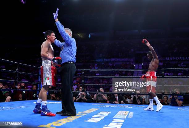 Guillermo Rigondeaux celebrates as referee Russell Mora calls off his fight against Julio Ceja during their super bantamweight fight at the Mandalay...