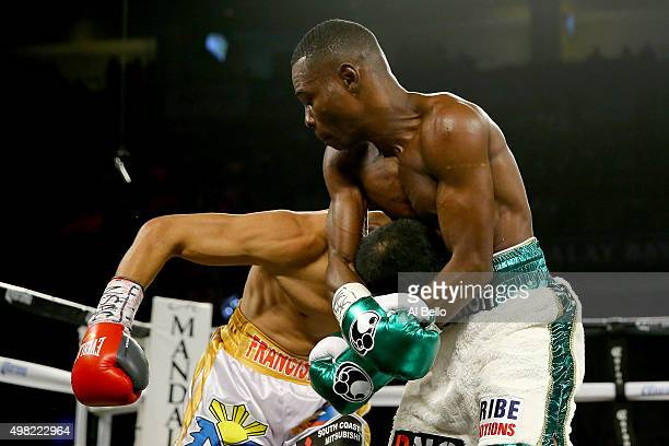 Guillermo Rigondeaux grabs Drian Francisco during their junior featherweight bout at the Mandalay Bay Events Center on November 21 2015 in Las Vegas...
