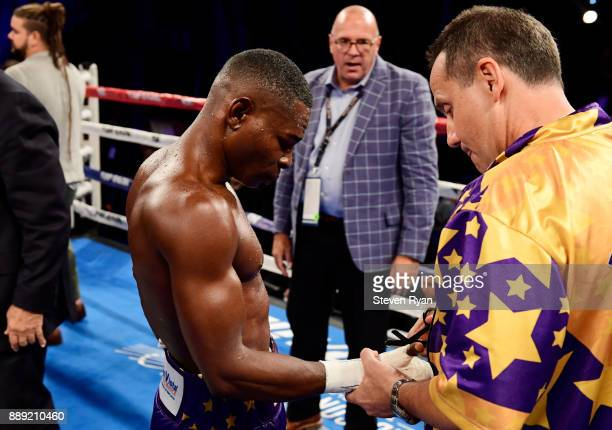Guillermo Rigondeaux has the tape removed from his right hand after retiring from his Junior Lightweight bout due to injury against Vasiliy...