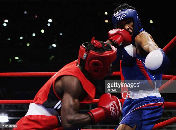Guillermo Rigondeaux Ortiz of Cuba and Worapoj Petchkoom of Thailand compete during the men's boxing 54 kg final bout on August 29 2004 during the...