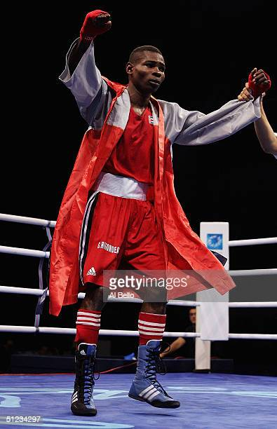 Guillermo Rigondeaux Ortiz of Cuba celebrates his win after the men's boxing 54 kg final bout on August 29 2004 during the Athens 2004 Summer Olympic...