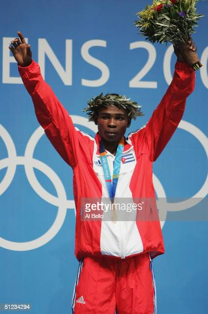 Guillermo Rigondeaux Ortiz of Cuba receives his Gold medal for the men's boxing 54 kg event on August 29 2004 during the Athens 2004 Summer Olympic...