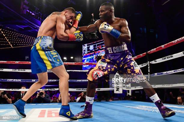 Guillermo Rigondeaux punches Vasiliy Lomachenko during their Junior Lightweight bout at Madison Square Garden on December 9 2017 in New York City